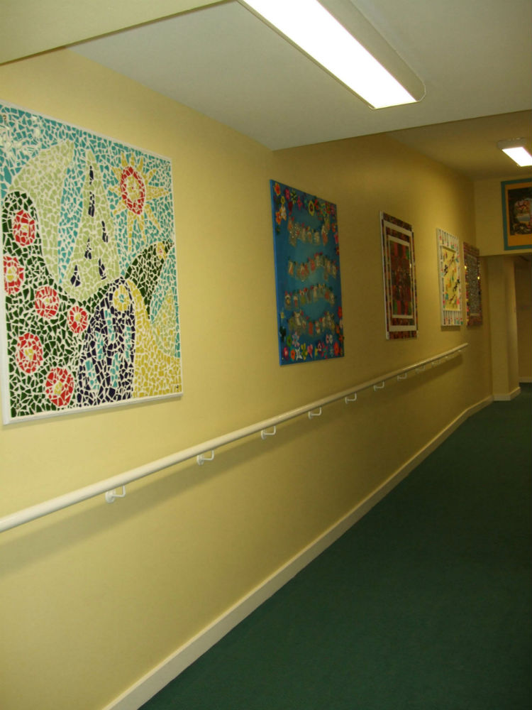 Mixed media work brightening up the school corridor KS2
