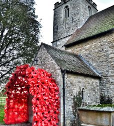 Poppy archway created with all the children from Scampton schools for Remembrance weekend with Lincolnhire Aviation Heritage