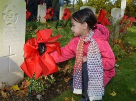 Placing the poppies during the remembrance event