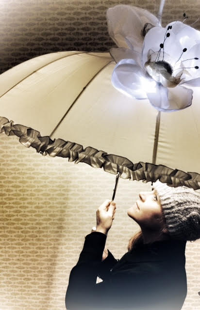 Light night umbrellas. Lit flowers and dancers